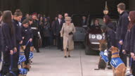 Exterior shots of the Queen and Duke of Edinburgh arriving at Battersea Dogs Home and being greeted by an 'honour guard' of dogs and handlers>> on...