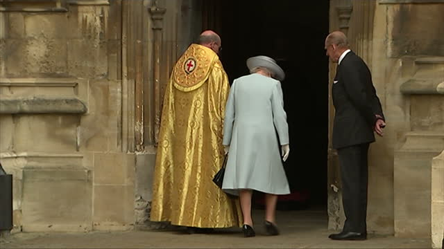 Exterior shots of The Queen and Duke of Edinburgh arriving at St George's Chapel Windsor for Easter service greeted by The Right Reverand David...