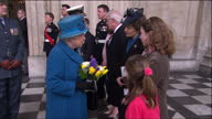 Exterior shots of the Queen and Prince Philip speaking to Sophie and Hannah Thorneloe whose father Lieutenant Colonel Rupert Thorneloe was killed...