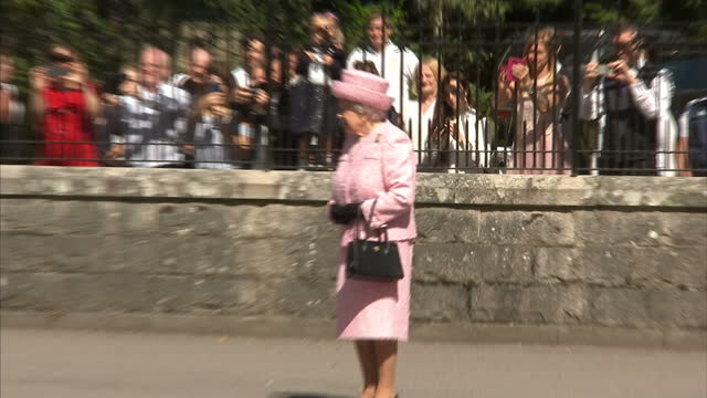 Exterior shots of the Queen arriving at Balmoral Castle and receiving the royal salute from the guard of honour from the Argyll and Sutherland...