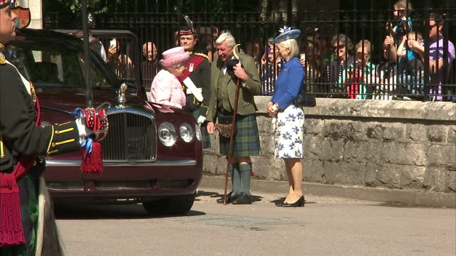Exterior shots of the Queen arriving at Balmoral Castle as the honour guard of the Argyll and Sutherland Highlanders stand to attention and members...