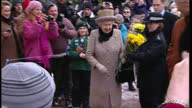 Exterior shots of The Queen departing Sandringham Parish Church shaking hands with an enthusiastic youngster on 5 February 2012 in Sandringham United...
