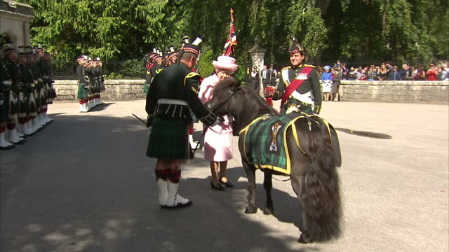 Exterior shots of the Queen inspecting the guard of honour of the Argyll and Sutherland Highlanders>> on August 07 2017 in Crathie Aberdeenshire