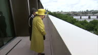 Exterior shots of The Queen looking over a balcony overlooking a police patrol boat on the Thames on a visit to the new headquarters of Scotland Yard...