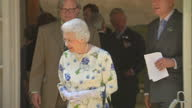 Exterior shots of the Queen Prince Charles and Camilla Duchess of Cornwall arriving departing the small window house in Buckingham Palace Gardens for...