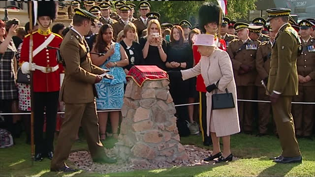 Exterior shots of the Queen speaking to members of the Royal Scots Dragoon Guards and unveiling a commemorative plaque at the regiment's new...