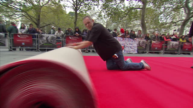 Exterior shots of the red carpet being rolled out in preparation for the BFI London Film Festival in Leicester Square Preparations for the 56th BFI...