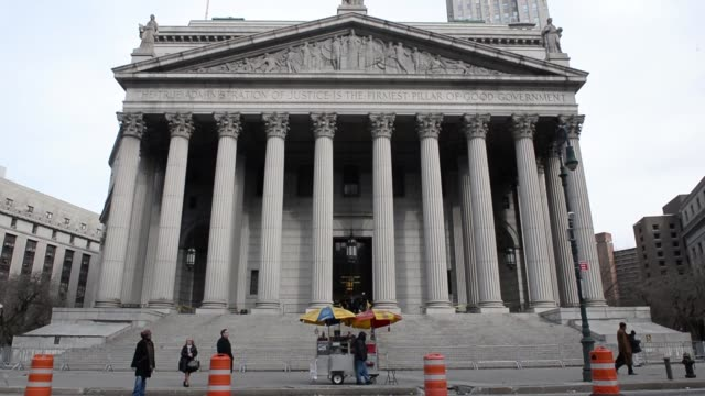 Exterior shots of the State Supreme Court at 60 Centre Street in Manhattan New York US Shots pan down from a street signe reading NO STANDING ANYTIME...