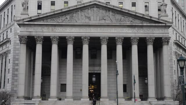 Exterior shots of the State Supreme Court at 60 Centre Street in Manhattan New York US Steady head on shots of the columns lining the entrance to the...