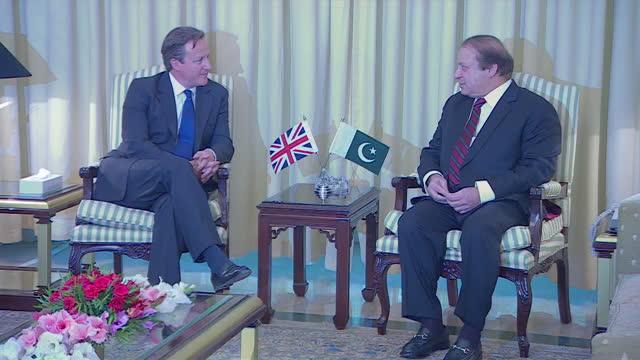 Exterior shots of the Union Jack and Pakistan flags outside the Pakistani Prime Ministers house David Cameron arrives to meet Nawaz Sharif Pakistani...