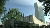 Exterior shots of the United Nations Headquarters in New York show flags of the member nations blowing in wind and building on September 23 2014 in...