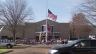 Exterior shots of the United States flag and the Mississippi state flag flying at halfmast outside Madison Central High School in honour of the death...
