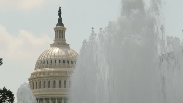 Exterior shots of the US Capitol including views of the Senate Fountain and the dome of the Capitol reflected in the Senate Park reflecting pool on...