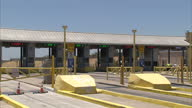 Exterior shots of the USMexico border crossing at Laredo with flags flying at halfmast in honour of the victims of the Chattanooga shootings and...