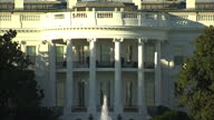 Exterior shots of the White House with a fountain outside on a sunny day on January 16 2016 in Washington DC