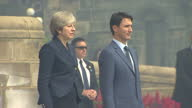 Exterior shots of Theresa May and Canadian PM Justin Trudeau stood as the National Anthems are played and walking into parliament building on 18...