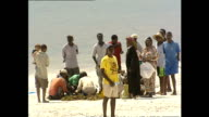 Exterior shots of tourists on a beach in Mombasa on December 13 2002 in Mombasa Kenya