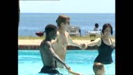 Exterior shots of tourists relaxing by the hotel swimming pool in Mombasa and doing water aerobics on December 13 2002 in Mombasa Kenya