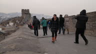 Exterior shots of tourists walking along the Badaling section of the Great Wall of China and taking photographs Scenic shots of the Great Wall of...