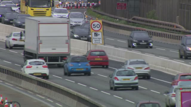 Exterior shots of traffic passing through a 50mph roadwork section of the M1 motorway on 21 October 2017 in London United Kingdom