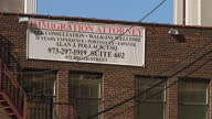 Exterior shots of two Homeland Security police cars parked outside a Federal Building in New York and the offices of an immigration attorney on...