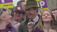 Exterior shots of UIKIP leader Nigel Farage posing for photos with UKIP supporters on November 08 2014 in Rochester England