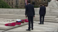 Exterior shots of UK party leaders Nick Clegg and Ed Miliband laying wreaths at the WW1 Centenary Commemoration Service for the Commonwealth in...
