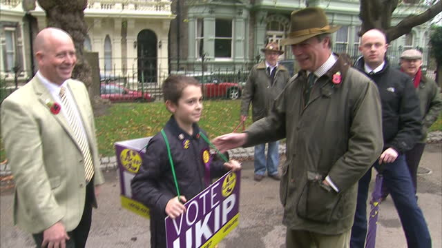 Exterior shots of UKIP leader Nigel Farage walking on the campaign trail in Rochester on November 08 2014 in Rochester England