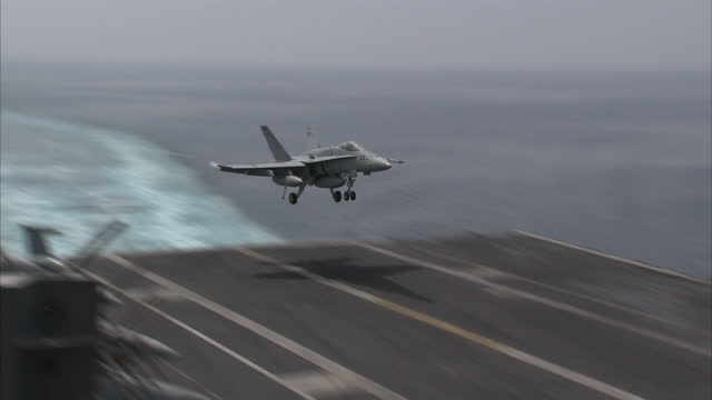 Exterior shots of US Fighter Jets landing on USS Carl Vinson on April 04 2015 in At Sea UNSPECIFIED Region UNSPECIFIED