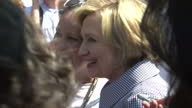 Exterior shots of US Presidential candidate Hillary Clinton walking and waving to crowds of well wishers on a visit to the Iowa State Fair on August...