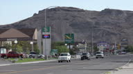 Exterior shots of various businesses at the side of Interstate 80 in the town of Wendover including a Sinclair petrol station a pawn shop with a...