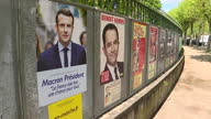 Exterior shots of various election campaign posters displayed on billboards outside a park including shots of several that have been defaced with...