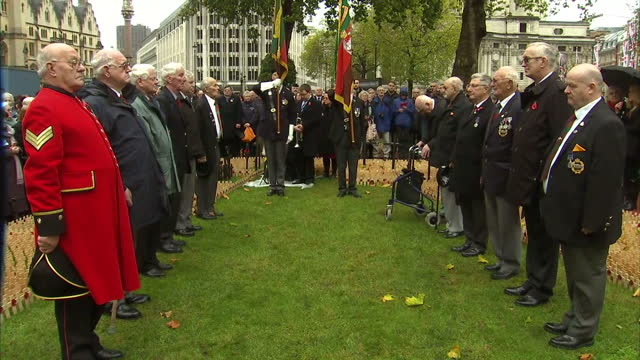 Exterior shots of veterans standing to attention and reflecting silently during Armistice Day commemorations at Westminster Abbey as the Westminster...