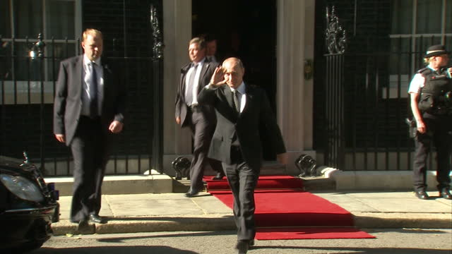 Exterior shots of Vladimir Putin departing Downing Street before getting into stretched car before being driven off Vladimir Putin departing Downing...