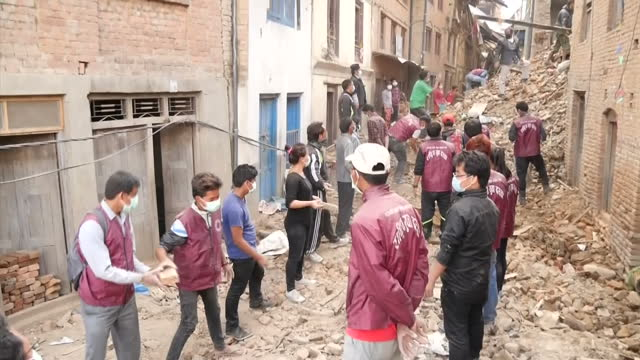 Exterior shots of volunteers military troops picking up rubble from a collapsed building after a major earthquake hit the area Filmed on April 30...