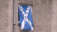 Exterior shots of 'Vote Yes' campaigners visiting properties and asking residents whether Scotland should be an independent country on July 11 2014...