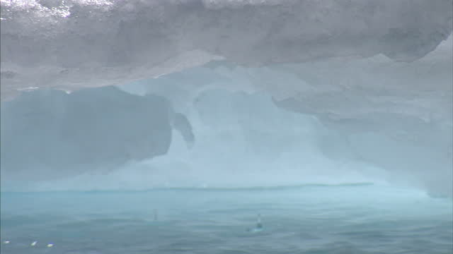 Exterior shots of water dripping from a melting iceberg on August 25 2007 in Cambridge Bay Canada