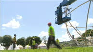 Exterior shots of workers constructing a spherical structure during Glastonbury Festival preparations>> on June 16 2009 in Pilton England
