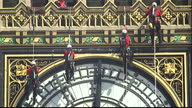 Exterior shots of workmen ascending on rope harnesses after carrying out cleaning work on the Great Clock of the Houses of Parliament>> on August 18...