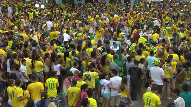 Exterior shots of World Cup football fans mostly in Brazilian colours celebrating in a Fanfest fan park in Manaus on June 12 2014 in Manaus Brazil