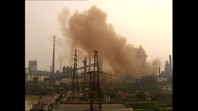 Exterior shots of Wuhan steelworks with lots of smoke rising from chimneys into the sky on February 2 2007 in Wuhan China