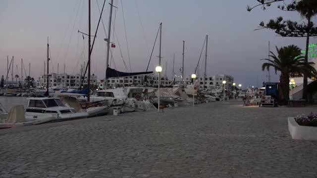 Exterior shots of yachts in a harbour and surrounding convenience and tourist shops on July 9 2015 in Sousse Tunisia