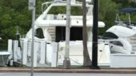 Exterior shots of yachts in Miami Florida on 012615 Wide shot of a single yacht passing along on the ocean Wide shots of yachts moored in rows next...