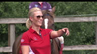 Exterior shots of Zara Phillips watching mounted girls wearing Musto clothing trotting and cantering around dressage arena Zara Phillips is at a...