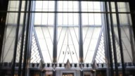 Exterior shots pan up the side of the Chrysler Building and pause on the iconic needle of the landmark skyscraper in New York NY Interior shots of...