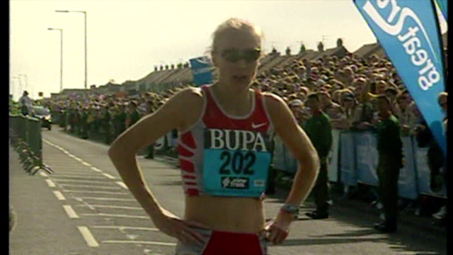Exterior shots Paula Radcliffe jogging towards finish line and breaking tape Paula Radcliffe cheering on September 21 2003 in South Shields England