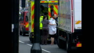 Exterior shots people being helped into the back of an ambulance by paramedics on July 07 2005 in London United Kingdom