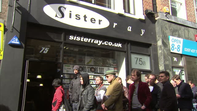 Exterior shots people queuing at Sister Ray Record Store Interior shots people browsing through records at records store on April 18 2015 in London...