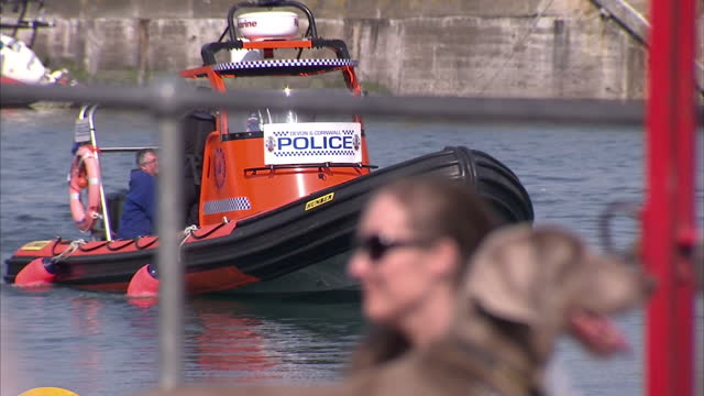 Exterior shots police car going through streets of Padstow Police speed boat coming in to shore BSKYB Executive Dies in Speedboat Crash on May 06...