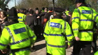 Exterior shots police moving fracking protesters along path on March 11 2014 in Eccles England
